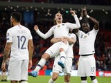 France's Antoine Griezmann celebrates qualifying for the Euro 2020 finals with team mates on November 17, 2019