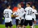Germany's Toni Kroos celebrates scoring their third goal with team mates on November 16, 2019