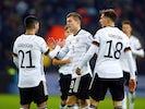 Germany's Toni Kroos celebrates scoring their third goal with team mates on November 16, 2019