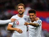 England's Harry Kane celebrates scoring their third goal with teammate Jadon Sancho on November 14, 2019