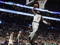 Boston Celtics guard Jaylen Brown (7) goes in for a dunk past Dallas Mavericks guard Tim Hardaway Jr. (11) during the fourth quarter at TD Garden on November 12, 2019