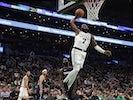 Boston Celtics guard Jaylen Brown (7) goes in for a dunk past Dallas Mavericks guard Tim Hardaway Jr. (11) during the fourth quarter at TD Garden on November 12, 2019