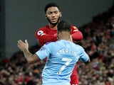 Liverpool's Joe Gomez and Manchester City's Raheem Sterling clash on November 10, 2019