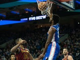 Philadelphia 76ers center Joel Embiid (21) dunks past Cleveland Cavaliers center Tristan Thompson (13) during the first quarter at Wells Fargo Center on November 13, 2019