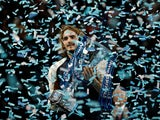 Greece's Stefanos Tsitsipas celebrates winning the ATP Finals with the trophy on November 17, 2019