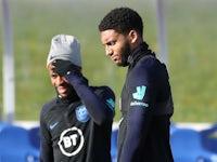 England's Raheem Sterling and Joe Gomez during training on November 13, 2019