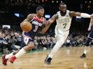 Washington Wizards guard Bradley Beal (3) drives against Boston Celtics guard Jaylen Brown (7) during the first half at TD Garden on November 14, 2019