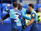 Wycombe Wanderers' Adebayo Akinfenwa celebrates scoring their first goal on November 17, 2019