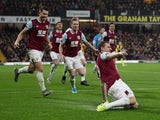 Burnley's Chris Wood celebrates scoring their first goal with teammates on November 23, 2019