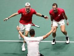 Canada's Denis Shapovalov and Vasek Pospisil celebrate after winning their doubles match against Australia's John Peers and Jordan Thompson on November 22, 2019