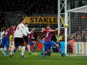 Crystal Palace's James Tomkins scores their first goal  which is then disallowed on November 23, 2019