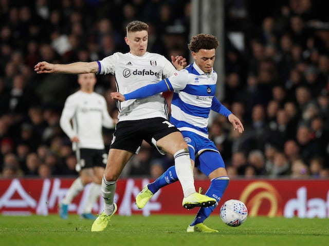 Fulham's Tom Cairney in action with QPR's Luke Amos in the Championship on November 22, 2019