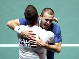 Britain's Dan Evans celebrates with captain Leon Smith after winning his match against Germany's Jan-Lennard Struff on November 22, 2019