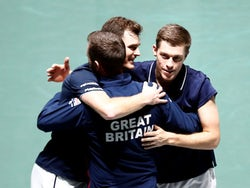 Britain's Jamie Murray and Neal Skupski celebrate with captain Leon Smith after winning their doubles match against Kazakhstan's Alexander Bublik and Mikhail Kukushkin on November 21, 2019