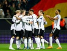 Germany's Serge Gnabry celebrates scoring their third goal with teammates on November 19, 2019