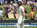 England's Jos Buttler walks off the pitch dejected after his wicket is taken by New Zealand's Neil Wagner on November 22, 2019
