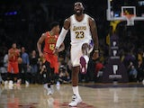 Los Angeles Lakers forward LeBron James (23) celebrates after a dunk by guard Danny Green (14) during the second quarter against the Atlanta Hawks at Staples Center on November 18, 2019