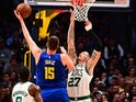 Denver Nuggets center Nikola Jokic (15) attempts over Boston Celtics forward Daniel Theis (27) in the second quarter at the Pepsi Center on November 23.