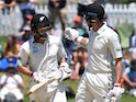 New Zealand's Mitchell Santner and BJ Watling walk off at lunch on November 24, 2019