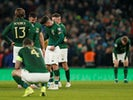 Republic of Ireland's Sean Maguire, Jeff Hendrick and teammates look dejected after the match on November 18, 2019