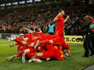 Wales' Aaron Ramsey celebrates scoring their second goal with Ben Davies and teammates on November 19, 2019