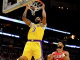 Los Angeles Lakers forward Anthony Davis (3) dunks over New Orleans Pelicans center Jahlil Okafor (8) during the first quarter at the Smoothie King Center on November 28, 2019