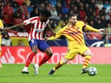 Barcelona's Lionel Messi in action with Atletico Madrid's Thomas Partey in La Liga on December 1, 2019