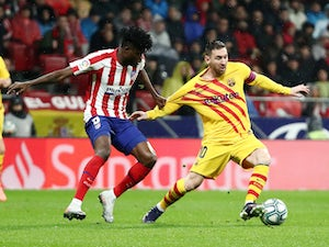 Messi scores late as Barca overcome Atletico