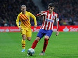 Barcelona's Antoine Griezmann in action with Atletico Madrid's Alvaro Morata in La Liga on December 1, 2019