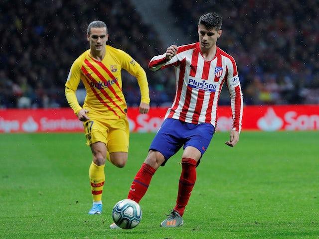 Barcelona's Antoine Griezmann in action with Atletico Madrid's Alvaro Morata in La Liga on December 1, 2019