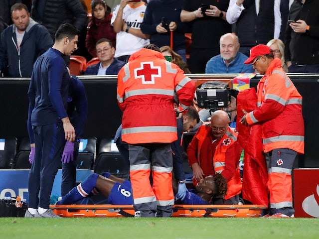 Chelsea's Tammy Abraham receives medical attention after sustaining an injury against Valencia on November 27, 2019