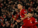 Dejan Lovren celebrates scoring for Liverpool against Napoli in the Champions League on November 27, 2019.