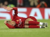Liverpool's Fabinho reacts after sustaining an injury on November 27, 2019