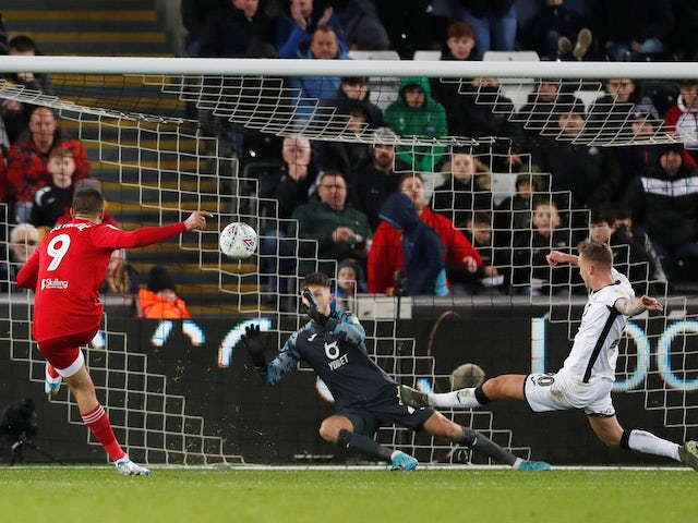 Fulham's Aleksandar Mitrovic scores their second goal against Swansea on November 29, 2019