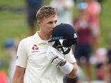 Joe Root kisses his own helmet after reaching a century on December 1, 2019