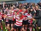 Kingstonian players celebrate with fans after the match pictured in November 2019