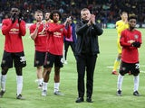 Manchester United manager Ole Gunnar Solskjaer and players applaud fans after the match on November 28, 2019