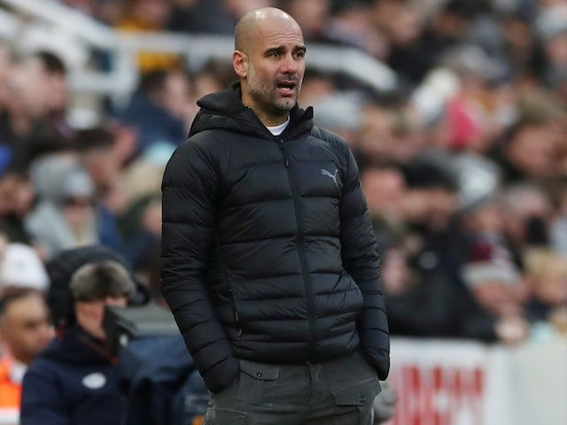 Man City boss Pep Guardiola watches on on November 30, 2019