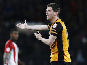 Former Hull and Ipswich defender Alex Bruce retires at 36