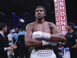 Anthony Joshua celebrates on December 7, 2019