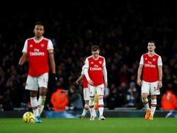 Arsenal's Mesut Ozil and Granit Xhaka look dejected after Brighton & Hove Albion's Neal Maupay scored their second goal on December 5, 2019