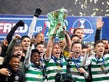 Celtic's Scott Brown celebrates winning the Scottish League Cup Final with teammates on December 8, 2019