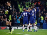 Chelsea's Tammy Abraham celebrates scoring their first goal with teammates as Aston Villa's Tom Heaton looks dejected on December 4, 2019