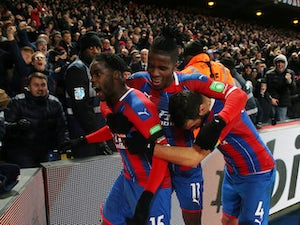 Ten-man Crystal Palace beat Bournemouth to move up to fifth