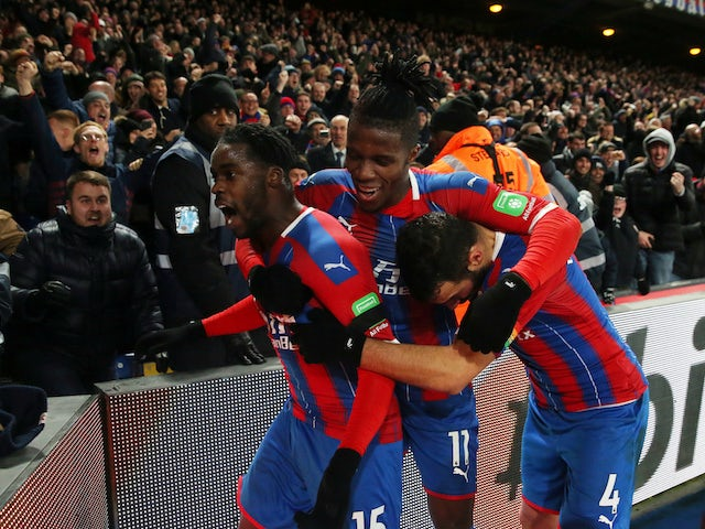 Crystal Palace's Jeffrey Schlupp celebrates scoring their first goal with Wilfried Zaha and Luka Milivojevic on December 3, 2019