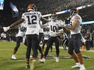 Chicago Bears quarterback Mitchell Trubisky (10) celebrates with teammates after scoring a touchdown run against the Dallas Cowboys during the second half at Soldier Field on December 6, 2019