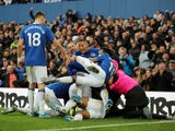 Everton's Dominic Calvert-Lewin celebrates scoring their second goal with teammates on December 7, 2019