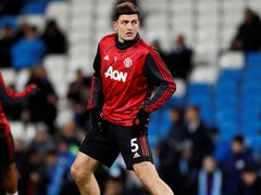 Harry Maguire warms up for Manchester United on December 7, 2019