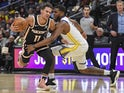 Atlanta Hawks guard Trae Young (11) is fouled by Golden State Warriors forward Kevon Looney (5) during the second half at State Farm Arena on December 3, 2019