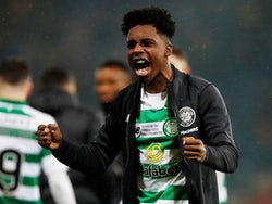 Celtic's Jeremie Frimpong celebrates winning the Scottish League Cup after the match on December 8, 2019